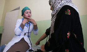 Mavluda Bobokalonova, director of the Rasht Reproductive Health Centre, provides a check-up and reproductive health counselling to a local woman. © UNFPA Tajikistan/Nozim Kalandarov